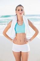 Gorgeous fit blonde in sportswear holding towel
