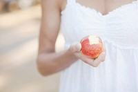 Womans hand holding apple