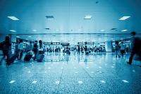 passenger motion blur in a transport hub