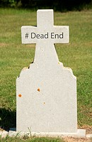 Hashtag Dead End written on an older marble tombstone with copy space.