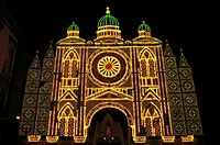 Night view of the facade of St Sabin Cathedral (11th-12th century) decorated with lights during the feast of the patron, Bari, Apulia, Italy.