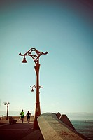 Evening run on promenade. A Coruña. Galicia. Spain.