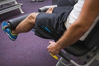 Side view of man doing leg workout at gym