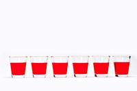 Six red color drinking water glasses on white background India Asia