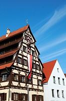 The Siebendächerhaus in Memmingen with city flag hoisted, Bavaria, Germany