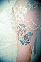 Skull tattoo on brides arm