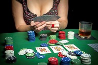 Very beautiful woman playing texas hold´em poker.