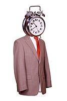 body with suit and tie with alarm bell as face