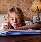 girl doing homework, Valencia, Spain