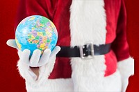 Composite image of santa has a globe in his hand