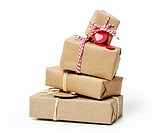 Stack of handcraft gift boxes on white background