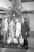 American actor Robert Wagner, British actor Peter Sellers, Italian actress Claudia Cardinale and French actress Capucine posing next to a Christmas tr...