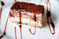 Tiramisu dessert on white plate.