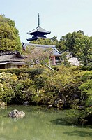 Ninna ji Temple, Kyoto, Japan, View across pond garden to Pagoda in background, Placed rocks, Trees, Cherry blossom, vegetation, Vertical