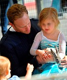 Ian Ziering and his two daughters play with the rabbits at the Farmer's Market Featuring: Ian Ziering,Penna Mae Ziering,Mia Loren Ziering Where: Los A...