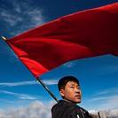 Student With Red Flag In Front Of Lake At Mount Baekdu, North Korea