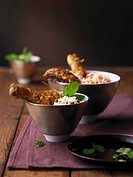Chicken tikka with lentils and pistachio rice in bowl