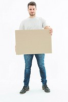 Confident delivery man carrying cardboard box