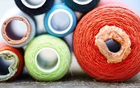 Front view on sewing spools. Macro colorful photo