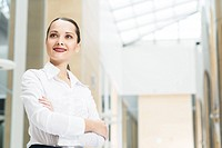 beautiful business woman standing in office with his arms crossed