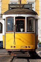 Typical yellow Tram in old street, Lisbon, Portugal