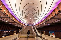 Couple embrace under the giant illuminated ceiling of the Plac Wilsona subway station, the capital´s only rapid transit system that connects central W...