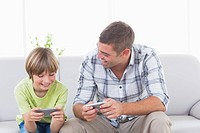 Father and son playing games on cell phone