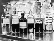 APOTHECARY BOTTLES, c1940. An assortment of medicines on display at a drugstore. Photograph, c1940.