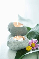 a set of candles with a wellness theme