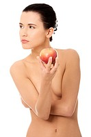 Beautiful woman with clean fresh healthy skin holding red apple. Isolated on white