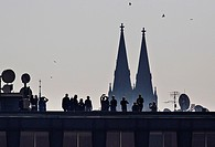 People watch solar eclipse on Prague's rooftops on Friday, March 20th, 2015. (CTK Photo/Rene Fluger)
