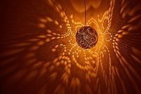 India, Rajasthan, Jaisalmer. Pierced lamp and shadows against wall.
