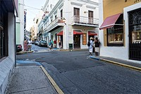 Typical Commercial Intersection in Old San Juan, Puerto Rico, with people talking, chatting, walking and shopping.