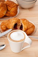 fresh croissant french brioche and coffee typical traditional Italian breakfast