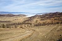 Road in Siberian landscape near lake Baikal