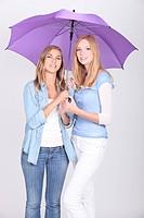 Girls under a purple umbrella