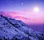 Photo of beautiful snowy mountains on purple sunset background, Faraya mountain in Lebanon covered with white snow, wintertime cold weather, moonlight...