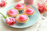 Pink cakes on blue plate.