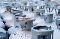 Metal LPG gas bottles in storage