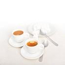 Italian espresso coffee fresh brewed macro closeup with sugar cubes