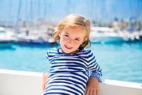 child kid girl in marina boat on summer vacations in Mediterranean