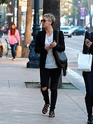 Kaley Cuoco shopping in Beverly Hills wearing jeans ripped at the knees Featuring: Kaley Cuoco Where: Los Angeles, United States When: 22 Dec 2014 Cre...