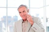 Senior businessman with headset on