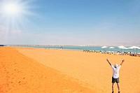 The enthusiastic tourist on the Dead Sea
