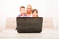 Mother with her Kids using a Laptop computer