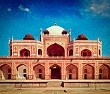 Vintage retro hipster style travel image of Humayun's Tomb with overlaid grunge texture. Delhi