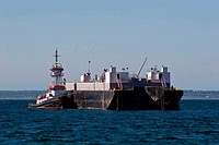 Tugboat Tied to Barge