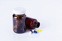 medicine bottles and tablets on white background