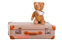 old sick teddybear on suitcase