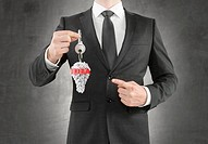businessman giving a key